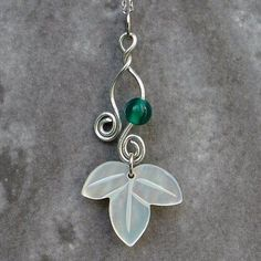 Mother of Pearl Leaf Design Pendant Necklace with Sterling Silver Chain Antique Alive Jewelry http://www.amazon.com/dp/B00790QBDY/ref=cm_sw_r_pi_dp_A1Gaub136DR7X