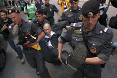 """Interior Ministry officers detain a gay rights activist during a gay pride parade, unsanctioned by the city authorities, near the mayor's office in central Moscow, May 27, 2012."" (Photo: Maxim Shemetov / Reuters)  http://newsfeed.time.com/2012/06/13/lgbt-pride-celebrations-around-the-world/#ixzz2vPyD4ztm"