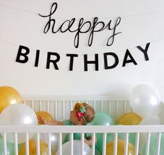 First year birthday photo idea.  Fill baby's crib with balloons & hang a Happy Birthday above bed.  Snap pics as little one enjoys the balloons & decorations. #firstbirthday