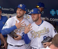 The Royal rings:   Kansas City Royals first baseman Eric Hosmer (L) and third baseman Mike Moustakas show off their World Series rings before the game against the New York Mets at Kauffman Stadium on April 5 in Kansas City, Mo.  -     © Denny Medley/USA TODAY Sports