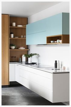 I LOVE the clean lines of the cabinets. I also LOVE the wood/white/colour mix. Also, I'd like a random little shelf. Maybe the existing shelf could be that?