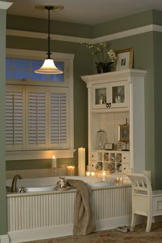 Bathrooms - this gives me some ideas for my master bath. I like the beadboard on the front of the tub face and also like the shelving system built in.