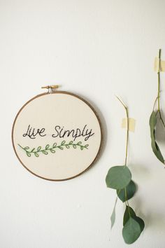▲ Live Simply Embroidery Art ▲ Embrace a life of minimalism with this hand stitched embroidery hoop art. HOOP DETAILS ▲ Your embroidery hoop is handmade in Louisville, KY. It is stitched on 100% cotto