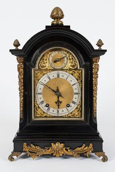Winterhalder  Hofmeier, an ebonised bracket clock: the eight-day duration movement striking the hours and quarter hour on two gongs with the backplate stamped WH Sch. with a matted dial centre, cast spandrels to the four corners and a regulation dial to the arch, the ebonised break-arch case with cast brass decorative mounts to the canted corners, cast side frets and front mount and cast finials and decorative bracket feet, height 48cm, including finial