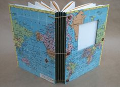 Expandable Travel Journal with Vintage World Map, pockets and envelopes for photos, scrapbook, art & collecting - Made to Order. $75,00, via Etsy.