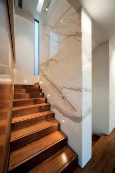 Talk about a sleek stairwell. Carerra marble creates a modern, yet classic look. Glenbervie House by Darren Carnell Architects