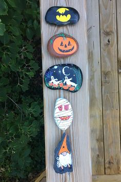 This Halloween Painted Rock set of five stones includes a pumpkin, a mummy, a gnome, and a bat. Each of the rocks is a natural river rock, except for the gnome which is an unbreakable slate stone. Painted Rocks For Sale, Hand Painted Rocks, Slate Stone, A Pumpkin, The Rock, Bottle Opener, Etsy Store, Clock, Halloween