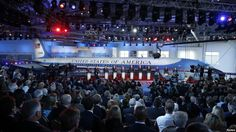 Eleven Republican U.S. presidential candidates debate in front of President…