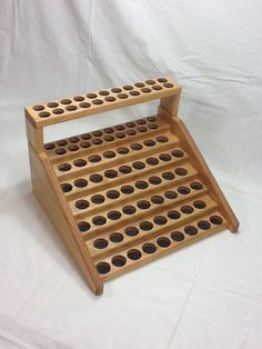 Large pine custom essential oil counter holder display rack with a custom add on top for more storage, or rain drop tray.