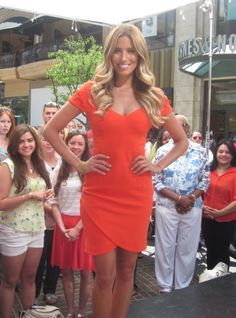 Extra on-air host, Renee Bargh, looking amazing in the ABYSS BY ABBY In The Scene dress in orange on June 6, 2012.