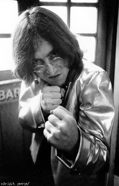 John Lennon. Given what I know of his teenage years, I'm sure he was a good fist fighter...