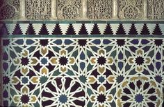 Image SPA 0119 featuring decorated area from the Alhambra, in Granada, Spain, showing Geometric Pattern and Floriated Arabesque using ceramic tiles, mosaic or pottery and stucco or plasterwork.