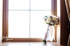 wedding photographer in maryland judah avenue photography took this photo of a  a wedding bouquet at the wedding at the george peabody library in baltimore maryland. We are wedding photographer in washington dc, maryland and virginia. we specialize in wedding photography  and are the premier wedding photographers in washington dc, maryland and virginia