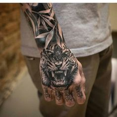 Tiger Tattoos for Men: Tiger tattoo can be the best choice if you love animal-inspired tattoo. These tattoo designs liked by both men and women. Tiger Hand Tattoo, Mens Tiger Tattoo, Tiger Tattoo Sleeve, Skull Hand Tattoo, Tiger Tattoo Design, Hand Tats, Sleeve Tattoos, Tattoo Designs, Dope Tattoos