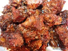 "Poor Man's Burnt Ends and Tips Our ""Poor Man's"" Burnt Ends are ""Off The Hook""! The burnt ends are meat candy. Burnt Ends are normally made from Brisket and that can be very expensive. But, as Larry Wolfe showed us you can use chuck roast. The Chew Recipes, Meat Recipes, Recipes Dinner, Recipies, Dinner Ideas, Traeger Recipes, Grilling Recipes, Healthy Grilling, Brisket Burnt Ends"