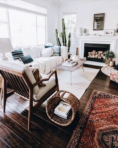What a charming and inviting room. I like the use of textures and mix of rugs.