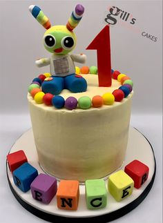 Buttercream covered cake decorated with sugarpaste robot, 1 and building blocks with their namr Hen Party Cakes, Cake Makers, Birthday Cake Decorating, Cake Cover, First Birthday Cakes, Creative Cakes, Celebration Cakes, Baby Shower Cakes, First Birthdays