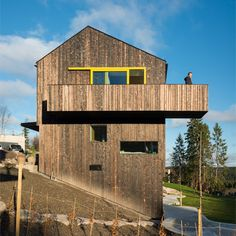Timber-clad home by Schjelderup Trondahl sits on a hill overlooking Oslo