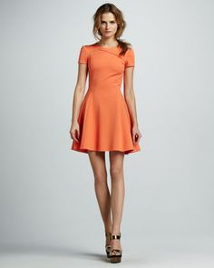"Cross-Neck Short-Sleeve Dress  3.5  2 Reviews  This Halston Heritage dress will turn heads with its punchy orange hue and retro-glam silhouette.  Crepe.  High scoop neckline with crisscross detail.  Short sleeves.  Fitted through hips.  Flared skirt.  36""L approx. from shoulder.  Back zip."