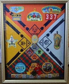 Commemorative shadow box for Cub Scouts neckerchief, patches and belt loops. Creative and a special way to feature all the hard work and achievements of my Cub Scouts! Boy Scouts, Cub Scouts Wolf, Tiger Scouts, Scout Mom, Boy Scout Sash, Boy Scout Uniform, Cub Scout Crafts, Cub Scout Activities, Camping Activities