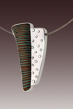 Reversible sterling and polymer pendant on cable with bayonet closureby e-bu Jewelry, via Flickr via marion the Librarian