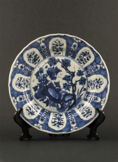 """Kangxi - Thin """"Kraak"""" style export dish with decor of scholar's rock in garden, cracked ice pattern and auspicious objects to the reverse"""