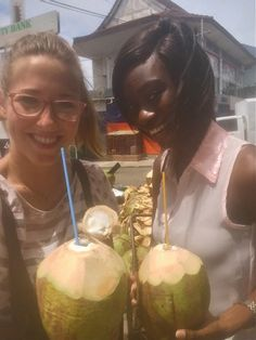 Friends sharing a sunny, happy moments drinking fresh jelly coconut water in Accra, Ghana.