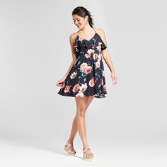 For a date night outfit made easy, slip on the Flutter Top Fit & Flare Dress from Xhilaration™. With the right accessories, this floral print dress can be worn all year long. Pair with strappy sandals for dinner on a restaurant patio or with a denim, leggings and booties for a stroll through the apple orchard.