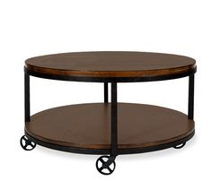 Arizona Round Coffee Table - The simplistic, yet unique look of heavily distressed wood with rustic metal is inspired from early 20th century artifacts. Constructed of select