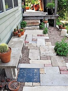 I like the mix-up of all the bricks, tiles, pavers. Looks cute. Author of Lawn Gone! @Pam Penick shows you how improve