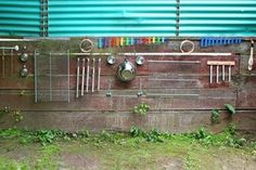 Homemade backyard music wall for kids by Filth Wizardry
