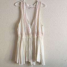 """Free People Trapeze RARE!! Flowy boho style tank/dress; 100% rayon; ultra soft with raw, unfinished assymetrical hem! Forgot the name of this! It's very very rare!! Eyelet detail with hook eye closure in front chest area! Opened on the bottom part! Intimately Free People! Measures 30""""-32"""" long! Can be used as layering for a dress too, Ivory in color! Free People Tops"""