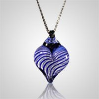 The Memory Pet Cremation Pendant is hand blown and formed to a wonderful glass cremation pendant in which the ashes of your loved one are molted in. You can see specs of ashes in the pendant. This will keep your loved ones close to your heart and be a family heirloom forever.