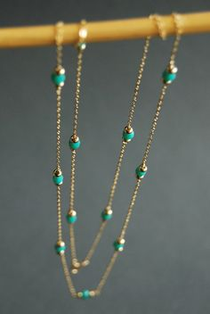 A pretty strand of turquoise glass beads.