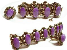 """VIntage bracelet & ring Suffragette purple cabachon fancy medieval . Through many decades before women got the right to vote, feminists in the United States and England signaled their desire for it by wearing jewelry that incorporated three colors: green for hope, white for the purity of their intentions and violet for dignity. As with """"regard"""" jewelry introduced in Georgian times, the first letter of a gemstone's name was short for something -- in this instance, Give Women (the) Vote. This…"""