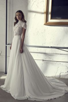 Romi - A stunning model off the Casablanca collection by NOYA. The Casablanca Bridal Gown Collection is a ready-to-wear line of wedding gowns by designer Riki Dalal.