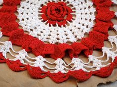 Is this not a potholder ? Have a lot of doilies & potholders. AL. Vintage Red and White Doily