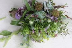 ... seed heads were used in this delicately naturalistic wedding bouquet
