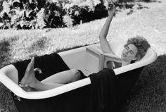 Brit Marling reading Wallace Stevens in a bathtub, courtesy of M.