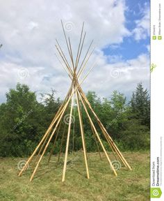 Photo about A view of the bare bones of a tepee setup with just the teepee poles looking from the side. Image of ground, canvas, indian - 97044010