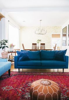 Obsessed with this teal sofa! Love it with the bright red vintage rug. Article is about: Choosing the right sofa for your space.