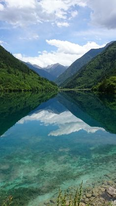 Jiuzhaigou is one of the most beautiful places in China but it is a full days bus ride from Chengdu (a good place to see giant pandas)...
