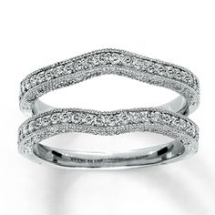 14K White Gold ½ Carat t.w.  Diamond Solitaire Enhancer... wouldn't mind updating my wedding band to this...