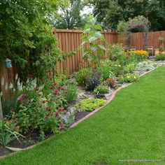 We love seeing fences lined with a colorful bed of plants and shrubs!