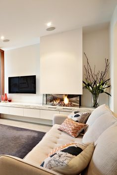 Modern living room with TV and fireplace and cabinet storage Living Room Decor Fireplace, Home Fireplace, Modern Fireplace, Living Room Tv, Fireplace Design, Interior Design Living Room, Living Room Designs, House Design, Home Theater