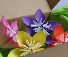 Mother's Day DIY Gift Idea – Origami Paper Corsages. I love how these are both angular and rounded!