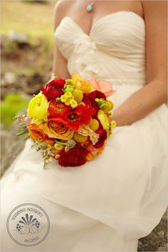 Bridal Bouquet Recipe:  Yellow, orange and red hybrid ranunculus and buds  Capriccio gold roses  Iceland poppies  Crespedia (Billy Balls)  Yellow button feverfew  Pieris Japonica (aka Lily of the Valley Bush)