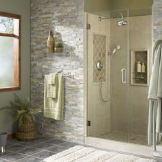 stone wall and smooth tile in shower - nice contrasts of texture yet colors blend well