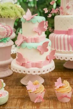 pink and teal butterfly wedding cakes