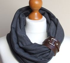 Circle scarf with leather pin. Hmmm . . . if I find a cuff bracelet, this would make a cute, original scarf treatment.